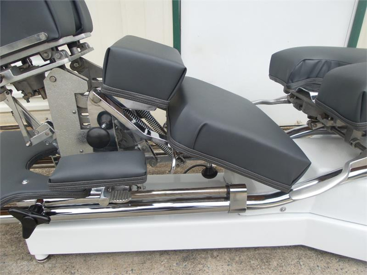 Used Zenith II 220F Hylo Table Shown with Breakaway Chest in Open and Locked Down position.