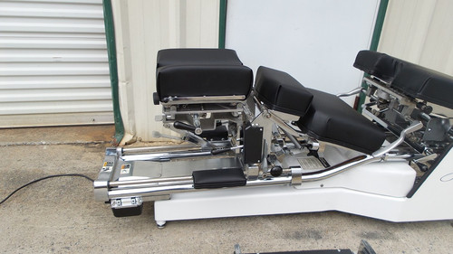 This Used Zenith II 220S Hylo Table is shown with Cervical Elevated and Breakaway chest open and locked in down position.
