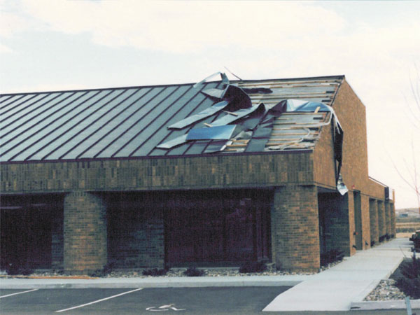 Wind Damaged Metal Roof