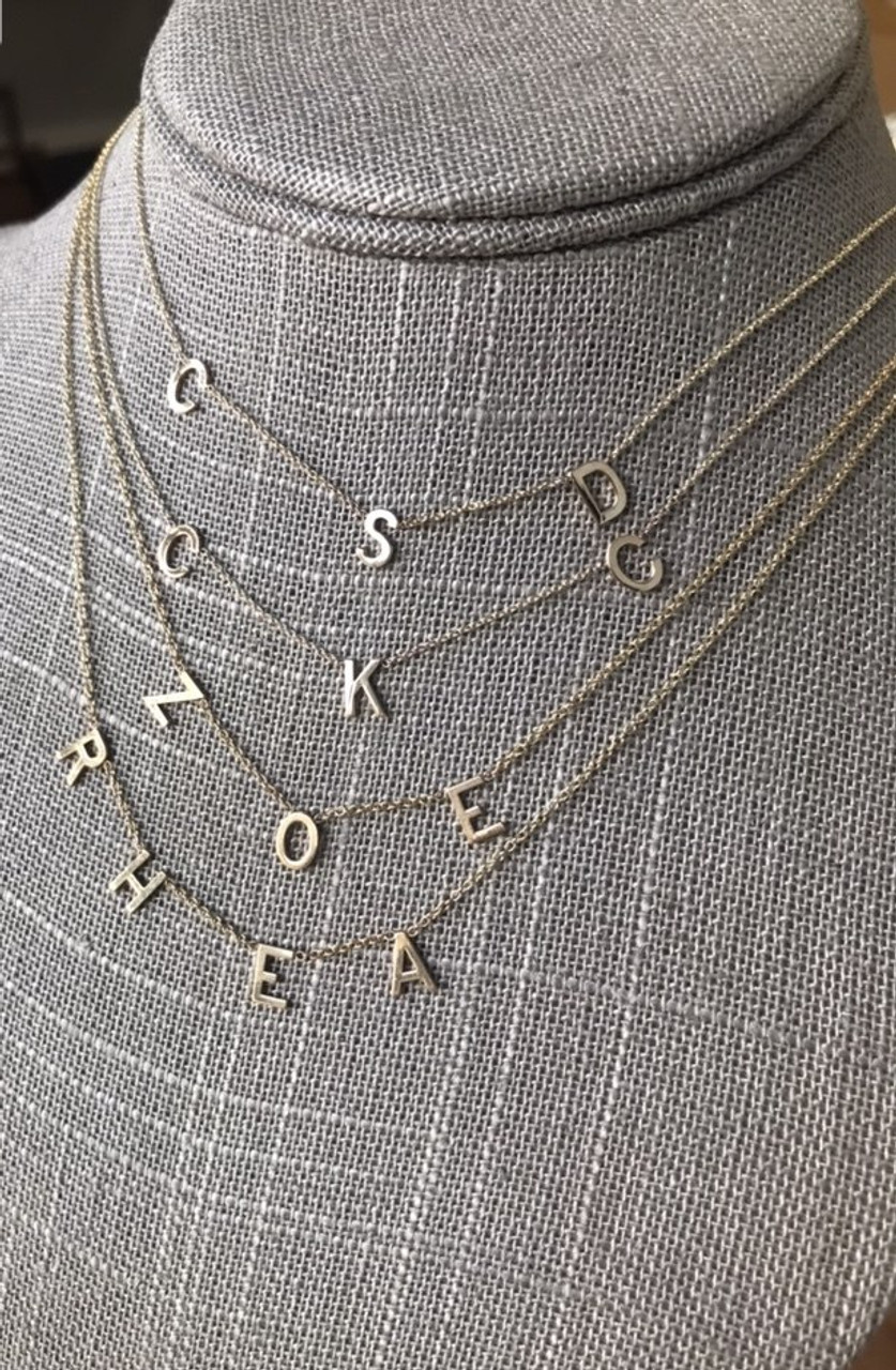 14k gold spaced letters necklace