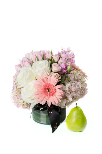 A Springtime Holiday favorite!  The perfect gift for a generous host or just to bring home for your own enjoyment.  A leaf-lined glass vase filled with hyrangeas, tulips, gerbera daisies, spray roses & more.