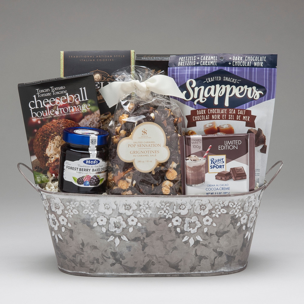 This lovely gift has been designed Just For Her! With both savoury & sweet items to create balance, we have to say that we really LOVE the chocolate treats found in this one...Snappers (pretzels, caramel & chocolate), Chocolate Pop Sensation (Belgian chocolate & sea salt drizzled over popcorn!), and RitterSport bar (best German chocolate!). So give this one to the gal who loves a little chocolate treat...she will be so glad you did!