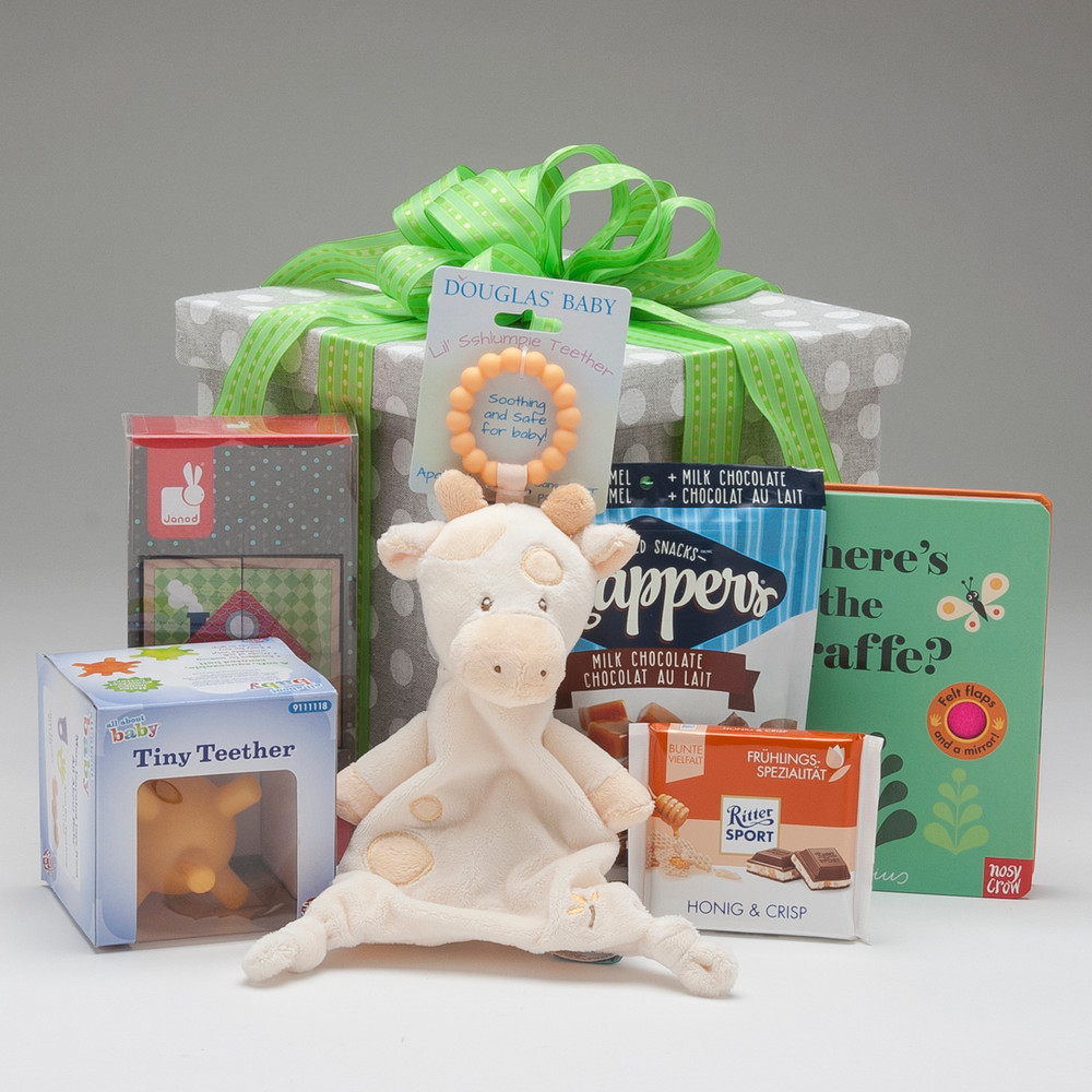 Sometimes a beautiful gift box is so much fun to open & discover...and so it is with this special box of hand picked items that are GENDER NEUTRAL, featuring the high quality toys, books & treats you've come to expect.