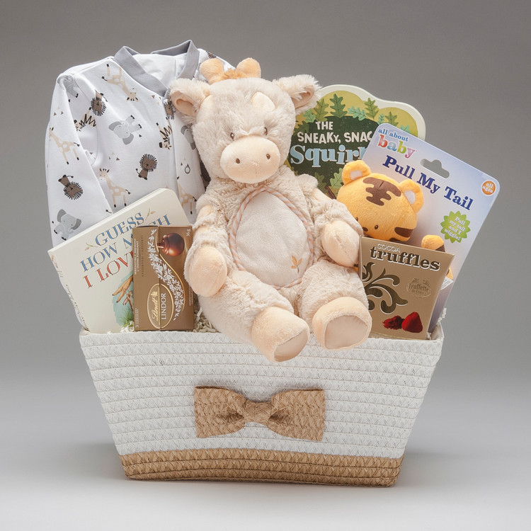 This sweet bow-tie basket comes loaded with plenty of wild animal friends; from the Pekkle sleeper wild animal print, to the Spotted Giraffe Plumpie by Douglas, to the Tiger that is full of surprises- pull the tail and see it wiggle and shake. Gender Neutral gift.