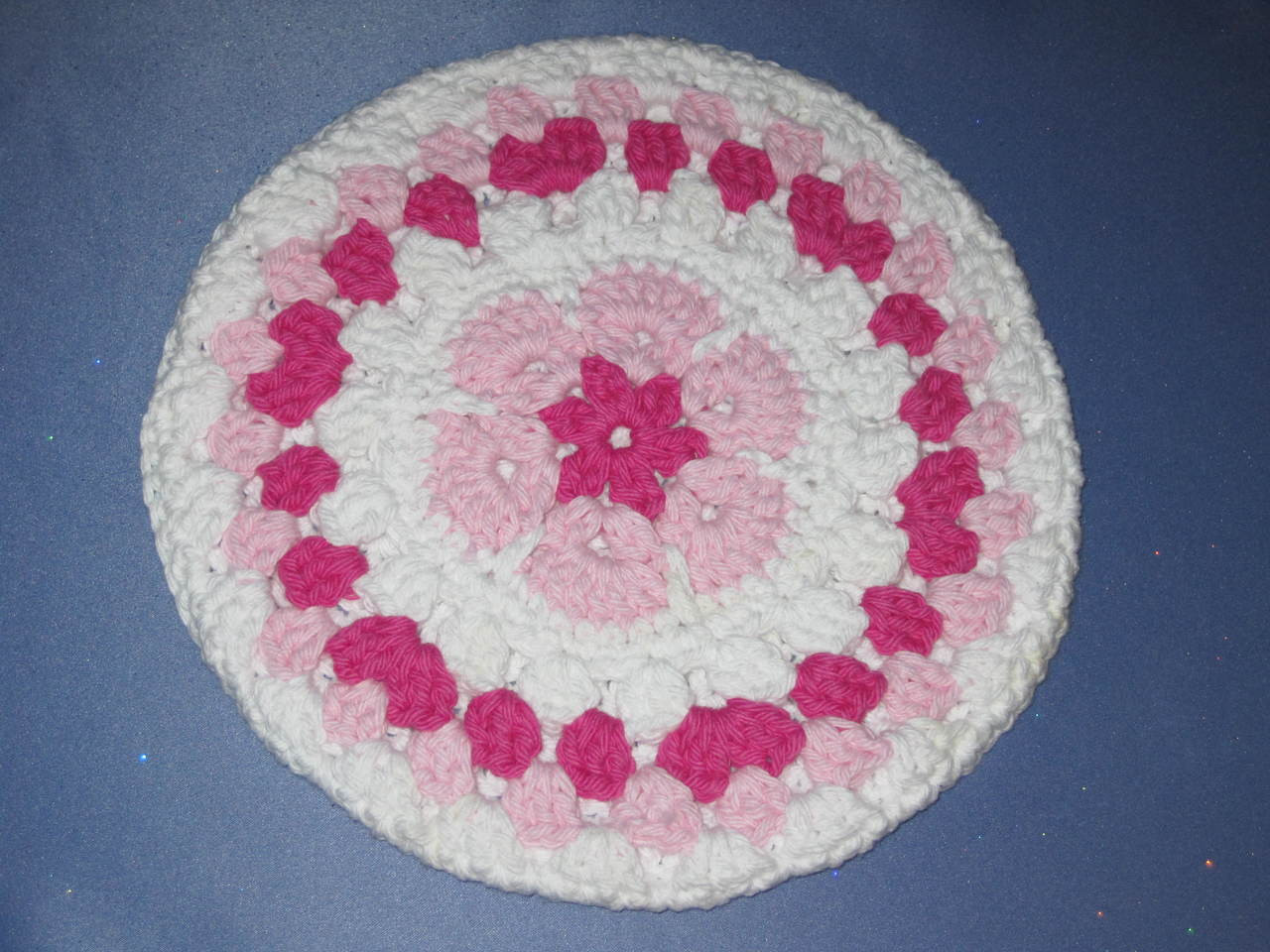 Round African Flower Potholder-Trivet in Pink and Frenc