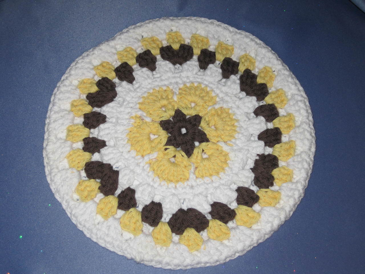 Round African Flower Potholder-Trivet in Yellow and Bro