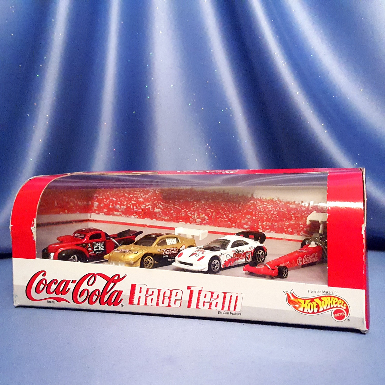 Coca-Cola Race Team 4 Piece Collection by Hot Wheels.