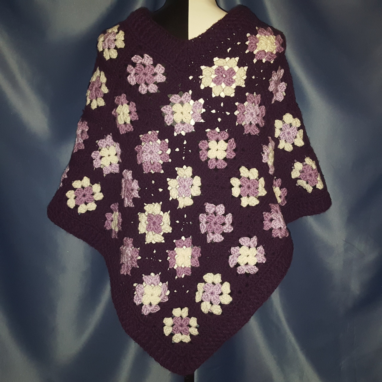 Granny Square Poncho in multiple Purples and White.
