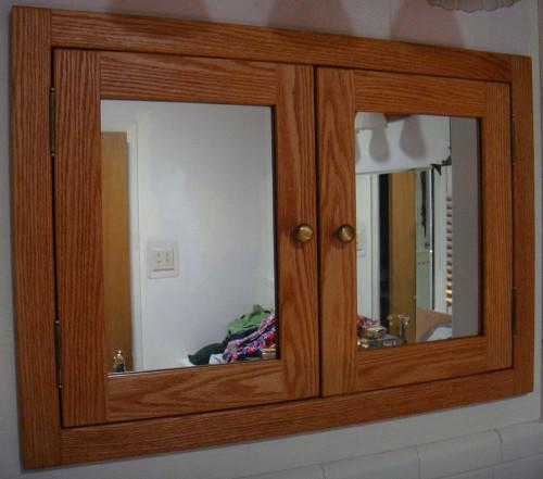 Recessed, Shaker Style, Double Door Medicine Cabinet With Mirrored Doors.