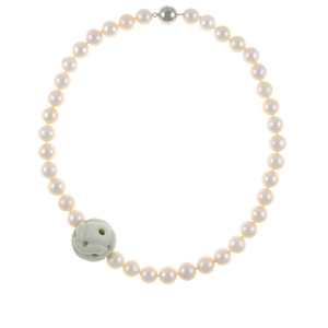 Mandalay Pearl Necklace: Single strand exceptional white freshwater pearls 10.5-11.5mm, featuring offset carved jade ball 25mm on individually hand-knotted natural silk with rare earth mixed metal magnetic clasp