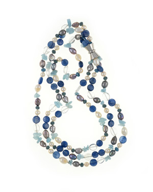 "Santorini Pearl necklace accented with stones  : Triple strand white 7mm round freshwater pearls, white 9x11mm and grey 8x10mm baroque freshwater pearls, crystal quartz, indigo, kyanite, and aquamarine, on individually hand-knotted natural silk with a rare earth mixed metal magnetic clasp, 18"" in length (princess length)"