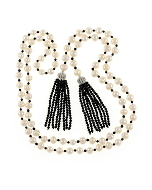 "Salome Pearl necklace, 9-10mm white round freshwater pearls separated with onyx, individually hand-knotted on silk, with 2 black onyx tassels can be worn wrapped, draped, tied, or looped, 50"" in length (rope length)."