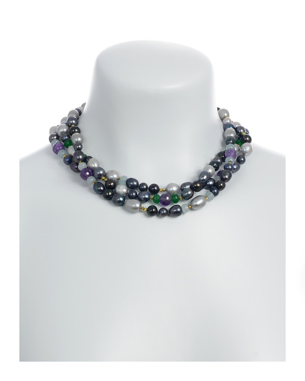 Andora - Pearl Necklace Accented with Stones Shown on model: Triple strand, silver and black colored round freshwater pearls 7-9mm, rice pearls 9-11mm, jade beads, amethyst beads, gold glass accent beads,   hand-knotted on dark gray silk with rare earth mixed metal magnetic clasp