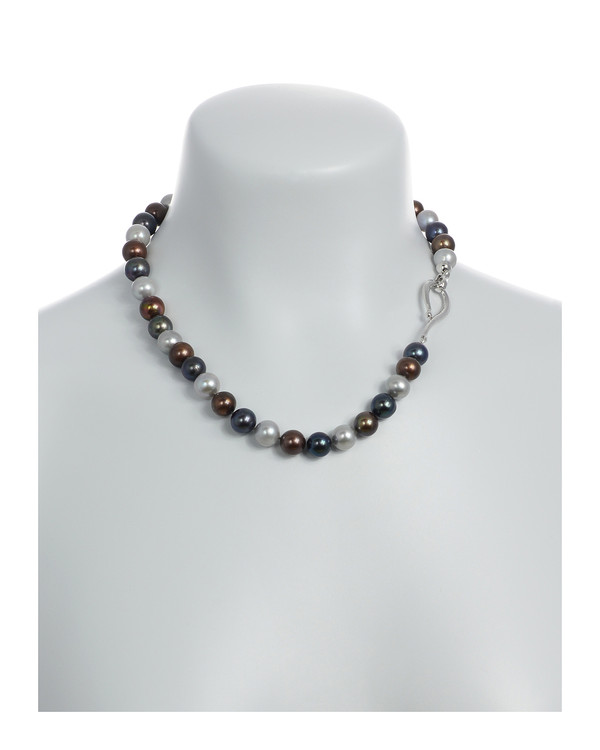 "Charbonnel - Pearl Necklace On model: Single strand mixed color freshwater pearls (chocolate, charcoal, and platinum) 10-11mm, on individually hand-knotted brown silk, silver metal locking ""S"" clasp, 19"" in length."