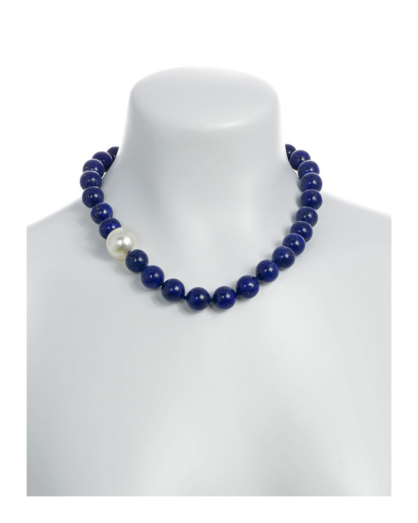 Côte d'Azur‎ - Lapis and Pearl Necklace On model: Single strand lapis beads 14mm flecked with pyrite, with offset shell pearl 20mm, on individually hand knotted black silk, featuring rare earth mixed metal magnetic clasp