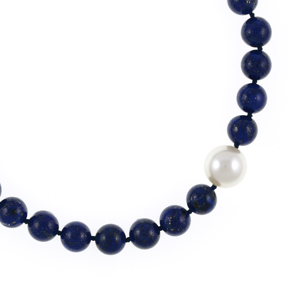 Côte d'Azur‎ - Lapis and Pearl Necklace Zoom showing offset shell pearl: Single strand lapis beads 14mm flecked with pyrite, with offset shell pearl 20mm, on individually hand knotted black silk, featuring rare earth mixed metal magnetic clasp