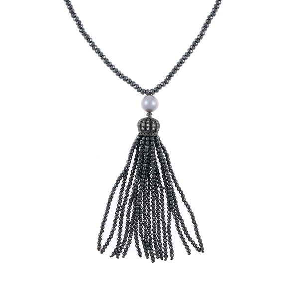 "Cotton Club Collection* - Hematite and Pearl Jewelry, Zoom of gunmetal tassel: Single strand gunmetal tone hematite bead necklace with white freshwater pearl 9mm, suspended with CZ set gold toned crown supporting  hematite bead tassel, overall drop 3"", 32"" in length."