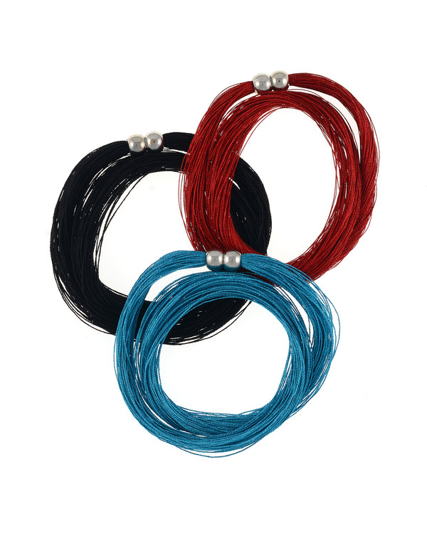 Danxia silk necklace,  shown in scarlet, teal, and black: Colored pure silk (75 strands) gathered together with a rare earth mixed metal magnetic clasp.