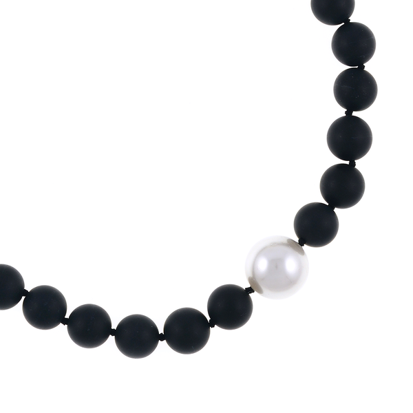 zoom London Eye Pearl and Onyx Necklace: Single strand black untumbled onyx beads 14mm, featuring an offset single shell pearl 20mm, on individually hand-knotted black silk, with rare earth magnetic mixed metal clasp