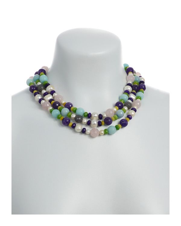 on model Mallory Square - Pearl and Gemstone Necklace:Triple strand white freshwater pearls 7-12mm, facet cut rose quartz, amethyst, agate, and jade, on hand-knotted natural silk with rare earth mixed metal magnetic clasp, princess to matinee length