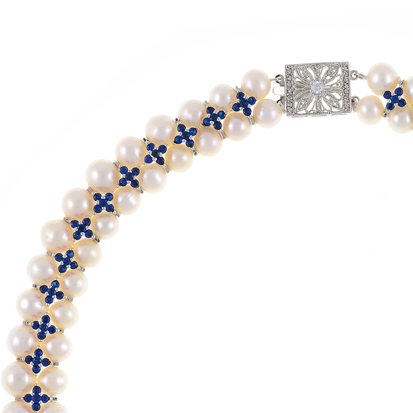 """zoom Monaco Royal necklace: double strand white 7-8mm freshwater pearls, white 8-9mm freshwater pearls, separated by stainless steel and royal blue colored CZ spacers, sterling silver clasp on hand-knotted natural silk, 18"""" in length with jump chain allows for additional overall 20"""" length, (princess length, expands to matinee length)"""
