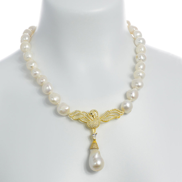 """Odette Anthology* - Pearl Necklace on model, Odette Gold-tone: Single strand white potato pearls 13-14mm, 7cm CZ gold-tone swan pendant with biawa 18-19mm, CZ covered gold-tone mixed metal locking circle clasp, 18"""" in length, princess length"""