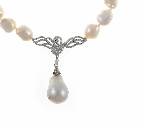 "Petit Odette Pearl Necklace in Silver, zoom on CZ silver-tone swan, Single strand white 11-12mm potato pearls, 5 cm CZ set silver-tone swan pendant with 13-15mm single biawa pearl pendant. CZ covered mixed metal locking circle clasp, 18"" in length (princess length)"