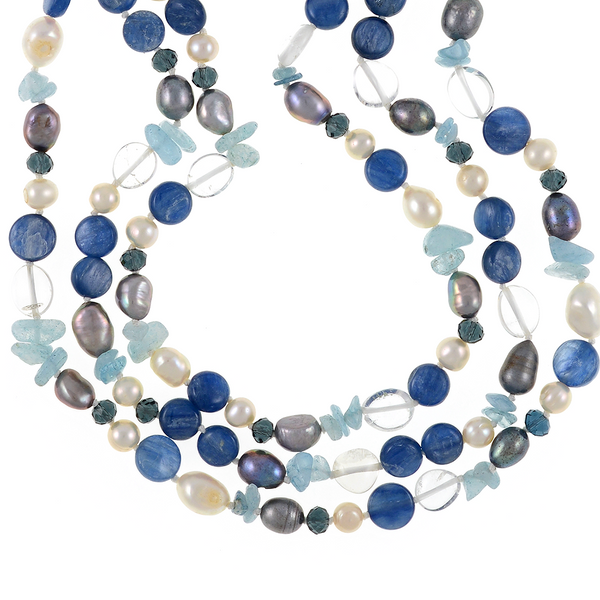 """zoom of Santorini necklace accented with stones : Triple strand white 7mm round freshwater pearls, white 9x11mm and grey 8x10mm baroque freshwater pearls, crystal quartz, indigo, kyanite, and aquamarine, on individually hand-knotted natural silk with a rare earth mixed metal magnetic clasp, 18"""" in length (princess length)"""