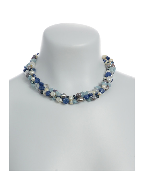"""on model, Santorini necklace accented with stones : Triple strand white 7mm round freshwater pearls, white 9x11mm and grey 8x10mm baroque freshwater pearls, crystal quartz, indigo, kyanite, and aquamarine, on individually hand-knotted natural silk with a rare earth mixed metal magnetic clasp, 18"""" in length (princess length)"""