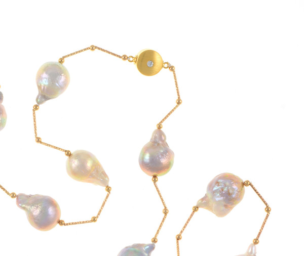 zoom of Appalachian Spring Pearl necklace pearls and moonlight clasp: Natural color pink 14-17mm edison pearls, brass separator and beads, brushed gold tone moonlight clasp set with a single CZ