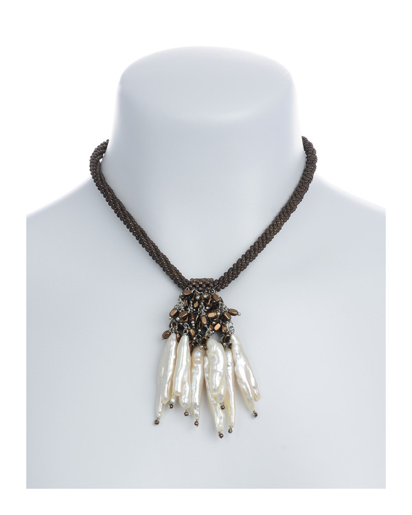 """The Luray Treasury* Pearl Necklace on model in Taupe: Hand-woven taupe matte hematite bead necklace with 8 dangling freshwater tooth pearls and matching polished hematite beads, with rare earth mixed metal magnetic clasp, 17"""" length with 2.5"""" tooth pearl drop."""