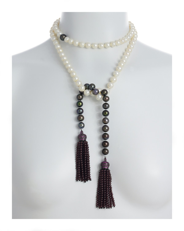 Grotta Palazzese - Pearl Necklace shown in model, tied style, 9-10mm exquisite white freshwater pearls mixed with 9-10mm black freshwater pearls individually hand-knotted on silk with two garnet-colored crown tassels set with pavé CZ's and 3mm garnet beads.
