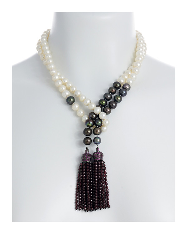 Grotta Palazzese - Pearl Necklace shown on model looped style, 9-10mm exquisite white freshwater pearls mixed with 9-10mm black freshwater  pearls individually hand-knotted on silk with two garnet-colored crown tassels set with pavé CZ's and 3mm garnet beads.