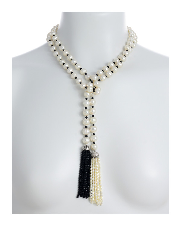 """Salome Pearl necklace necklace with white and black tassel, 9-10mm white round freshwater pearls separated with onyx, individually hand-knotted on silk, on model, can be worn looped as shown, 50"""" in length (rope length)"""