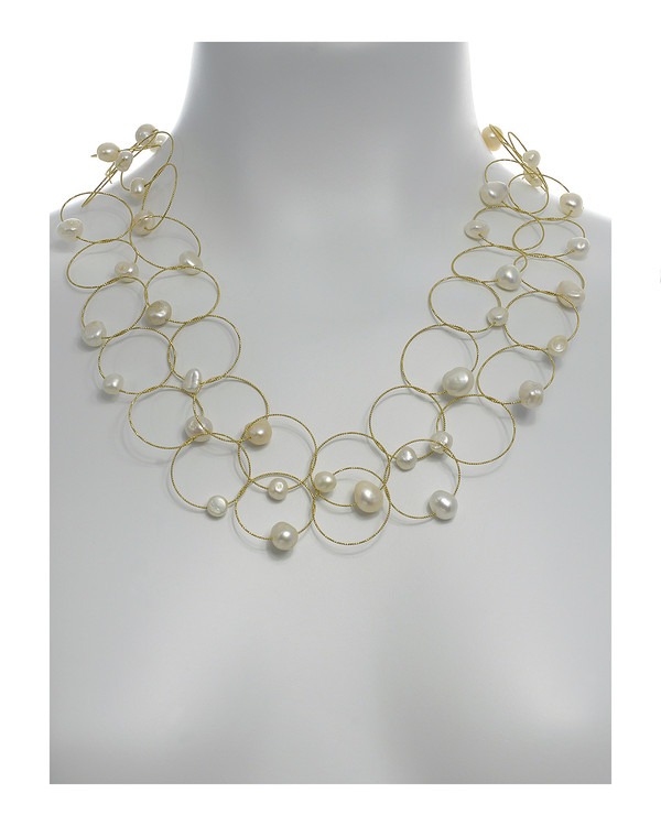 "Truilli - Pearl Necklace,    36 white freshwater pearls, 7.0-11.0 mm, on individual intertwining shiny textured brass rings,  Pearl necklace can be converted from a 45"" long lariat style necklace to a choker style necklace with the included gold-toned converter, shown on model with converter in use"