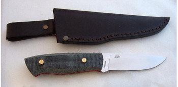Showing the flat grind EnZo Trapper with Black Canvas Micarta Scales