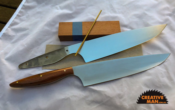 """Showing this Chef 220 blade in a kit and as a completed project, this one with Sydney Red Gum, white vulcanised spacers and brass 1/8"""" pins."""