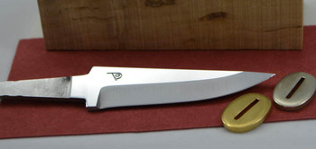 Blade shown with optional bolster, spacer material and handle block. An example of a complete knife making kit