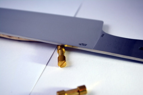 Detail of blade with optional corby bolts in brass
