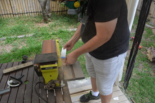 shaping the handle on a belt sander