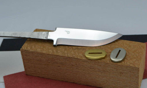 Showing an example of completing a knife kit using the Polar 82 hunting knife blade, a bolster in either brass or nickel silver, vulcanised fibre spacer material, and a solid wooden block for handle material.