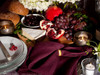 Linoto linen napkins enhance rich Thanksgiving dinner table.