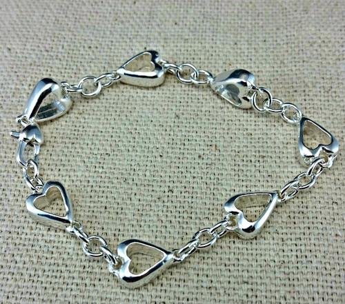Seven of Hearts Link Bracelet in solid sterling silver