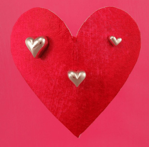 Three puffed heart post earrings with the brushed finish Large, Medium, Small,  sizes vary in width from 5 to 11 mm