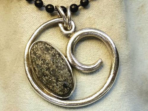 , beachcomber beach pebble sterling pendant comes on a black cotton cord