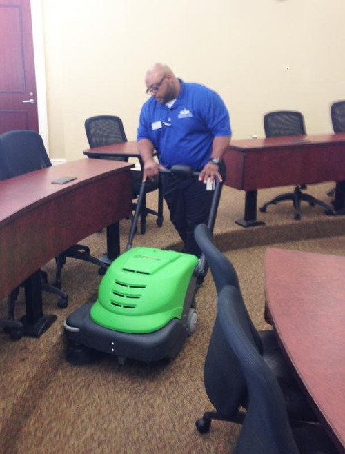 The 464 Smart Vac sweeper is small enough to clean between desks in college auditoriums.