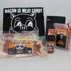 It's Not Kosher, but it's Tasty Hanukkah Bundle includes two packs of gourmet bacon, chocolate covered bacon strips, Bacon Freak's bacon flavored seasoning, Bacon Is Meat Candy logo t-shirt and Boss Hog's Maple Bacon Coffee Beans.