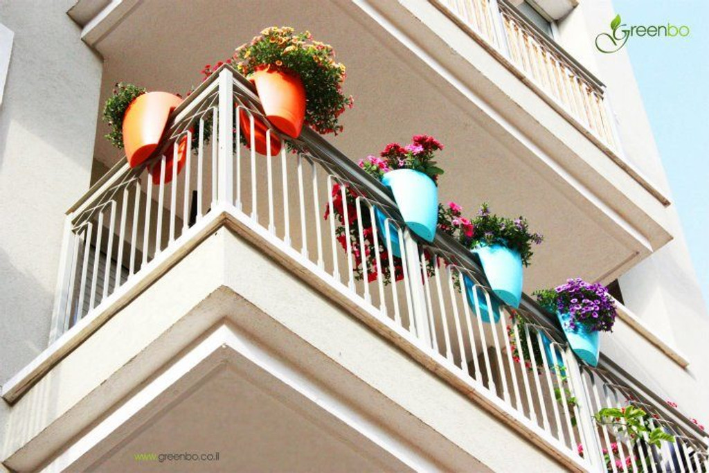 Greenbo railing planters on balcony.