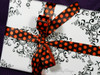 """Our 7/8"""" orange dots make this gift box perfect for little Halloween treats!"""