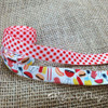 A barbecue with red and white gingham are made to go together! Designed and printed in the USA!